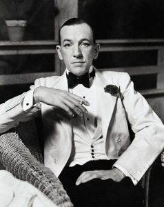 "1936 --- Noel Coward formally attired and with a cigarette for the play, ""Tonight at 8:30."" Photograph, 1936. BPA2 #1837 --- Image by © Bettmann/CORBIS"